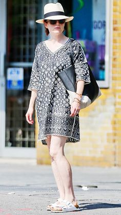 Julianne Moore in a printed tunic, white Birkenstocks, black and white tote and a Panama hat.