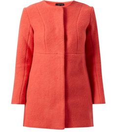 """In a soft wool blend, and a sophisticated structured design, this red collarless coat works from office looks to evening wear. Perfect for dressing up a classic pair of skinny jeans.- Simple long sleeves- Boiled wool blended fabric- Slim fit-  Concealed fastening- Seam detail- Model is 5'8""""/176cm and wears UK 10/EU 38/US 6"""