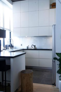 The hood and electric range are built in, flush with the rest of the glossy cabinetry