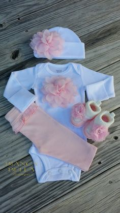 Dress your little princess up in this beautiful pink and white outfit, which includes bodysuit, ruffle bumm pants, matching hat and booties. This outfit can be purchased with or without the matching booties. Please make your selection at checkout. Bodysuit, pants and hat are 100% soft cotton. Perfect for taking your sweet baby girl home from the hospital, or an awesome baby shower gift!  White bodysuit and hat are adorned with dainty light pink chiffon flowers.  ****Available with your…