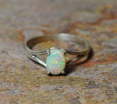 Simple opal ring.