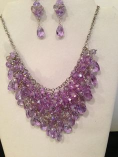 Synthetic alexandrite this statement necklace uses Fiery Violet Crystals that change color to Blue depending on the light