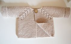 This seamless little top down cardigan is an intuitive knit, suitable for an experienced knitter. Worked in garter stitch with a simple, effective raglan pattern which adds just enough interest when knitting. The pattern comes with schematic.
