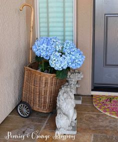 French Country Spring House Front Porch with Blue Hydrangeas