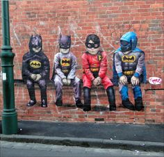 Clever street art of 3 Batmans (in different attire from different Batman movie…