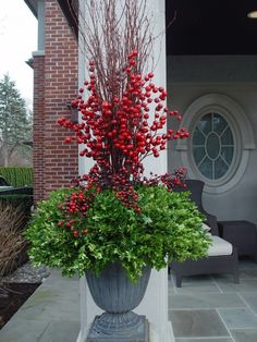 Michigan holly, are spectacular but fragile.  The berries in these urns will look great all winter, and can be removed the beginning of March.  The boxwood might need a little floral dye sprayed on it by then, but I like keeping the pots intact until April sometime.