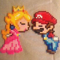 Princess Peach and  Mario perler beads by lizdejesus23 (original design by geekmythologycrafts)