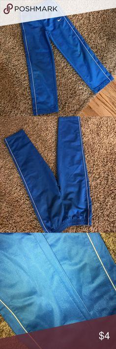 Nike Pant Elastic waist fleece backed medium weight woven nylon pant. Worn at the knees a little. No holes Nike Bottoms Sweatpants & Joggers