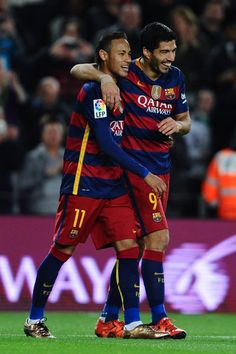 Luis Suarez (R) of FC Barcelona celebrates with his teammate Neymar of FC Barcelona after scoring his team's fourth goal during the La Liga match between FC Barcelona and Real Betis Balompie at Camp Nou on December 30, 2015 in Barcelona, Catalonia.