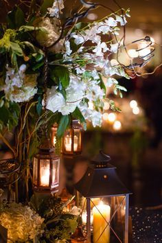 lanterns on metallic linens wedding centerpieces - Google Search