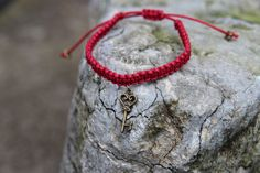 A personal favorite from my Etsy shop https://www.etsy.com/uk/listing/208806674/red-key-red-adjustable-macrame-bracelet