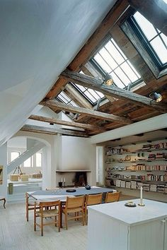 I love the vaulted ceiling and the mix of modern paired with the original vintage, rustic touches.