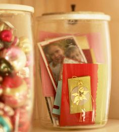 Decoratively Store Tags and Ornaments  Pretty Christmas tags look great on more than gifts -- store them in see-through containers on a bookshelf for a hint of the holiday. Ornaments and other small baubles also look great in this type of display.
