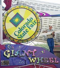 Greg Miranda, of Corpus Christi, Texas, pauses momentarily while helping to assemble The Giant Wheel ferris wheel Saturday in the Midway of the Colorado State Fair. The ride belongs to Crabtree Amusements and requires four semi tractor trailers to transport it. The Giant Wheel is also scheduled to make an appearance at the Louisiana State Fair in Shreveport, La., in October. (Chieftain photo by Brian Kelsen, 8/18/2012)