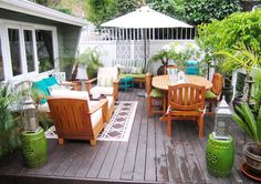 Deck decor ideas... I like a comfy seating area, the green stools/tables for extra seating, eating area and outdoor rug!