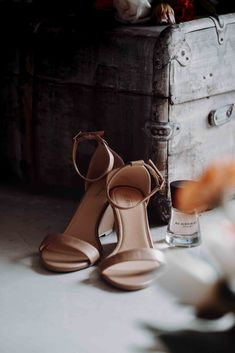 Simple and elegant bridal shoes paired with a bridal perfume gift. Printed Gowns, Bridal Shoes, Cape, Perfume, Pairs, Sandals, Elegant, Purple, Heels