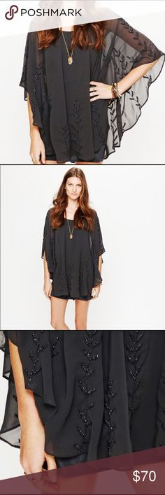 Free People Embellished Cape Dress Beaaaauuutttifulll cape by Free People. Embellished with a timeless, feminine design. Perfect for the boho chick at heart that has events to attend. The silk slip is attached. The dress is super comfortable and also very flattering. Perfect for dancing, as the sleeves look especially majestic when you raise your hands. I've only worn it once, so it's in great condition and not missing a single bead. The color is a mix of navy and grey. Free People Dresses…