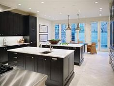 This kitchen remodel has a classic contemporary design that fits this 100-year-old Philadelphia brownstone. Traditional ebony stained cabinets mix with stainless steel appliances.