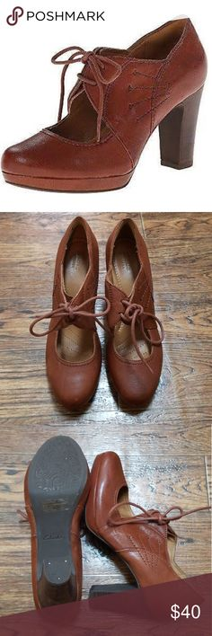 """Clarks Leather Cognac Flyrt Dally Lace Up Heel A lace-up platform pump cast in finely grained leather lends a touch of vintage sophistication to your everyday style.  3 1/2"""" heel. Pictures show condition. Clarks Shoes Heels"""