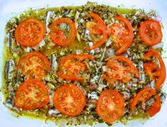 This may simply be one of the healthiest and tastiest meals you will ever eat. Rich anchovies roasted in olive oil with garlic, herbs and topped with tomato. Healthy Diet Recipes, Low Carb Recipes, Healthy Eating, Mediterranean Dishes, Mediterranean Diet Recipes, Greek Diet, Sardine Recipes, Good Food, Yummy Food