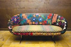 beautiful couch - lovely oval shape and suzani upholstery!