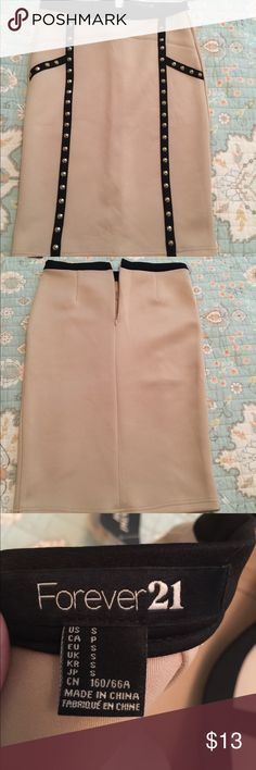 "Tan and black skirt with gold studs Tan and black with gold studs Forever 21 skirt size S.. knee length.. My height is 5'5"" Forever 21 Skirts Pencil"