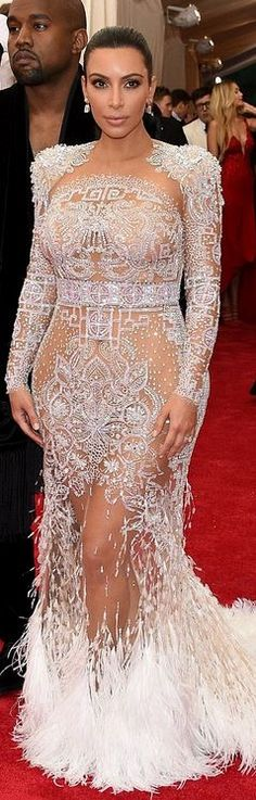 Who made  Kim Kardashian's white lace long sleeve gown?