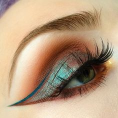 Unique steampunk makeup look with iridescent copper eyeshadow with winged liner