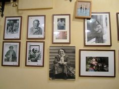 Italian Enoteca with framed photos covering the walls.