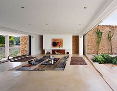 sunken living/dining area with retractable doors