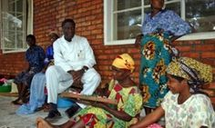 Dr. Denis Mukwege chats with women at his treatment centre in eastern Congo.