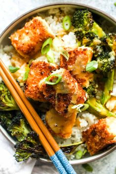 Coconut Crusted Tofu with Habanero Pineapple Sauce and Ginger Coconut Rice is a healthy recipe thats loaded with flavor. The coconut crusted tofu is cooked to golden brown perfection, drizzled with a sweet and spicy sauce, and then served atop fragrant rice. And this dish is vegan and gluten free! | CatchingSeeds.com