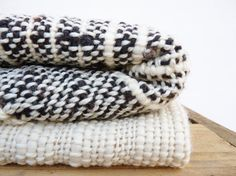 Black sheep and white sheep blanket for bed or sofa made of 100% organic merino wool undyed super soft. The throw blanket wrap is made by hand in