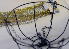 Make a Beaded Chandelier using Dollar Store Wire Plant basket and Mardi Gras Beads --clear directions - great for Mardi Gras decor sans the spray paint Hanging Wire Basket, Wire Baskets, Dollar Store Crafts, Dollar Stores, Bead Crafts, Diy Crafts, Diy Lampe, Deco Luminaire, Mardi Gras Decorations