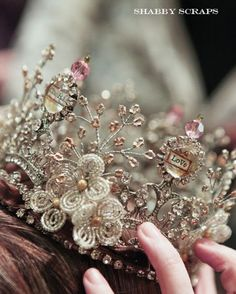 I once made a tiara almost like this. I used silver wire, glass and crystal beads, and made flowers and branchy things like this. But it wasn't quite as elaborate.