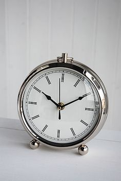 small chrome case clock with traditional face clock dimensions