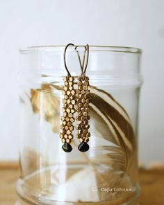 Hand stitched elegant earrings. A metallic pattern with a tiny dark green tourmaline briolette dangling below. Oxidized brass handmade french ear wires.