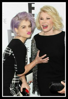 """""""Fashion Police"""" stars Kelly Osbourne and Joan Rivers get a bit hands on! Kelly is obviously wondering how the 79-year-old stars breasts are only 20!"""