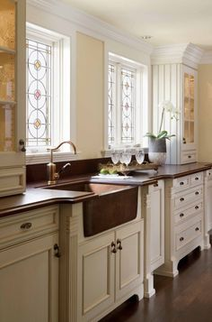 Pretty  Like copper sink and wood counters.  Where do you dry those hand washed items?