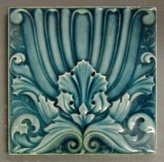 """Craven Dunnill and Co relief moulded dust pressed tile with a formalised floral design Prussian blue glaze, 6"""" square, c1900"""