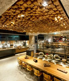 "Starbucks's Concept Shop in Amsterdam called The Bank. It's a 4,500 square foot subterranean location that's made up of floating community gathering spaces, an in-store bakery, and lots of local design elements, including walls clad in bicycle inner tubes. The biggest claim to fame, though, is the Coffee Theatre, where baristas will ""develop new coffee brewing methods"" and offer ""small batch reserve coffees available nowhere else on the continent."""