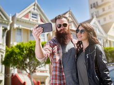 couple taking selfie in front of painted ladies in - couple taking selfie in front of painted ladies in san francisco