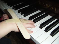 Heidi's Piano Studio: New Tool for Teaching Wrist Movements--OR!!! this could be an airplane for gross motor time that allows children to focus on wrist rotations...hmmm...?