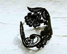 black lace cuff. I could make this myself, and it would look awesome with the dress I want. :)