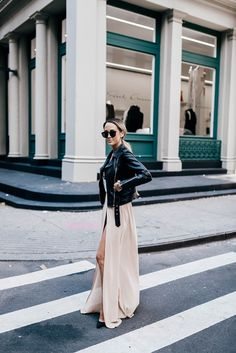 Megan Anderson mixes ballroom and biker girl chic in this fabulous outfit, consisting of a floor length gown with slit detailing and a classic leather jacket. With a pair of shades, this look is simply perfect for a fresh take on the maxi dress this...