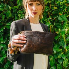 Brown Natural Real Leather & Cow Hair Clutch Bag – by Derbyshire based handbag brand Amilu    The Lydd Clutch bag in Brown Natural is made from real Italian nappa leather and soft cow hair. This bags contrasting and tactile textures give it a luxurious look and feel and can give a simple outfit a unique edge.     FREE UK DELIVERY    #countrychic #cowhide #cowhair #realleather #clutch #smallbag #countrygirl #uniquebag #uniquegift