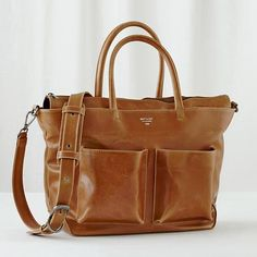 You don't have to sacrifice style in a diaper bag to have more space. This faux leather Matt & Nat Diaper Bag has lots of both.