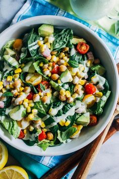Roasted Corn Tomato Summer Salad with Lemon-Basil Yogurt Dressing- crisp lettuce topped with roasted chickpeas, sweet corn, creamy avocado and juicy tomatoes then finished off with a flavorful yogurt dressing. The best of what summer has to offer! (vegan, gluten-free, grain-free)