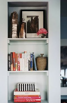 A nice blend of objects and books.  Also you always need to place the books vertically and horizontally.