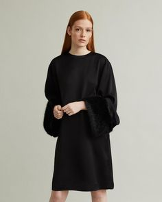 This luxurious dress is made from a lustrous fabric, with faux fur cuffs in black. Perlo features a round neckline, wide long sleeves as well as and oversized body, and a hook and eye fastening at back. Designing Women, Silk Dress, Faux Fur, Fitness Models, Elegant, Apothecary, Long Sleeve, Fabric, Sleeves